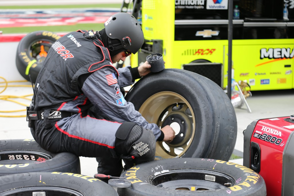"""They not only ""Screw 'em on,"" but also ""glue em' on."" A special high temperature adhesive on the back side of each rim helps with wheel stability, the Las Vegas XFINITY race Saturday, Las Vegas, Nev., Mar. 5, 2016 