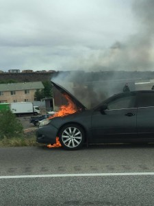 A gray Subaru sedan caught on fire on Interstate 15 in St. George, Utah, April 27, 2016 | Photo by Melissa Humphries, St. George News