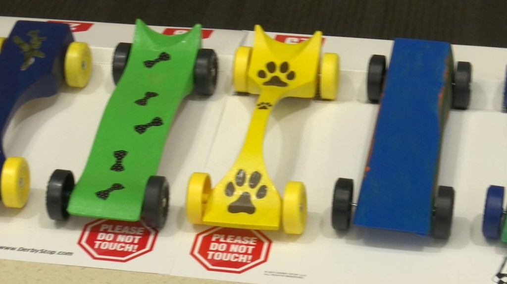 Handcrafted cars donated by Kent Cook and painted by residents and family members entered the Pinewood Derby Extravaganza held at the Southern Utah Veterans Home, Ivins, Utah, April 30, 2016|Photo by Austin Peck, St. George News