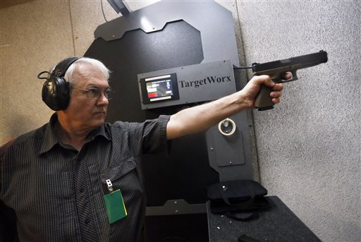 Dr. Michael Victoroff, a physician in the Denver area whose leisure-time passion is competitive shooting, practices at a range in Centennial, Colorado. Across the U.S., suicides account for nearly two-thirds of all gun deaths, with 21,334 gun deaths by suicide in 2014, according to federal data. Victoroff has become increasingly engaged in suicide prevention, and serves on a state working group seeking to raise awareness of the issue among primary-care doctors. Centennial, Colorado, March 11, 2016 | AP Photo by Brennan Linsley, St. George News