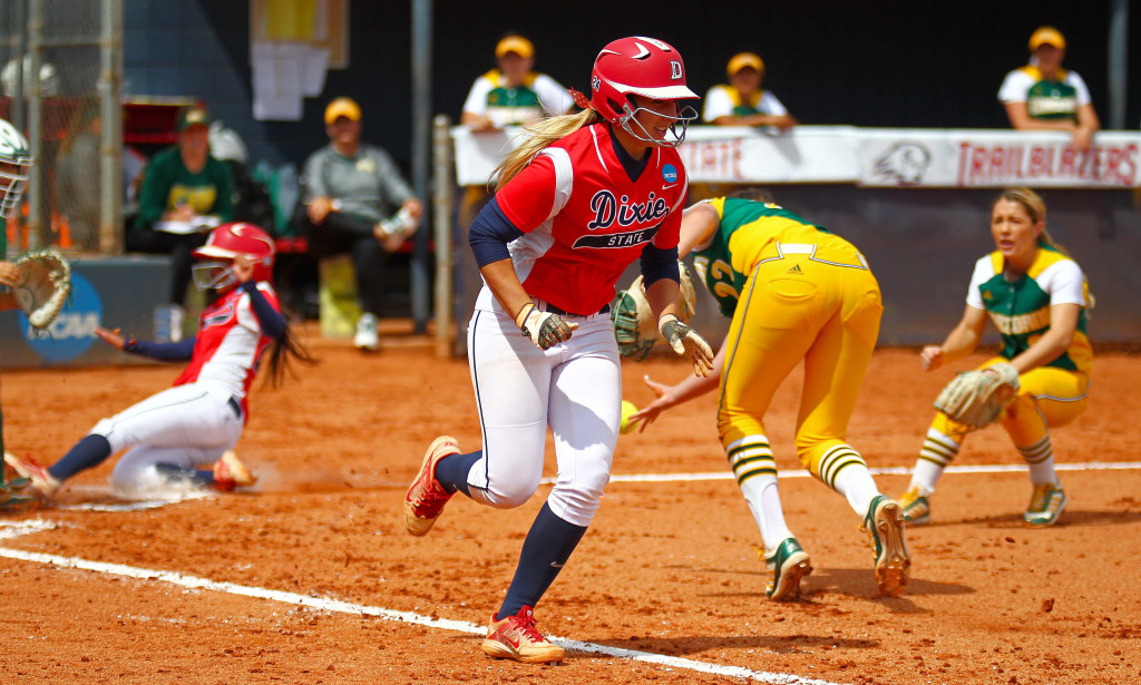 Dixie State's Mallory Paulson (24) heads to first base as Shelby Yung (23) scores, Dixie State University vs. Concordia University, Softball, St. George, Utah, Apr. 30, 2016, | Photo by Robert Hoppie, ASPpix.com, St. George News