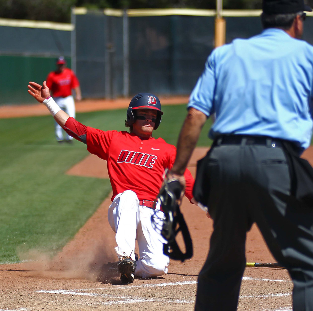 Dixie State's Drew McLaughlin (2) slides in to home safely, Dixie State University vs. Hawai'i Pacific University, Baseball, St. George, Utah, Apr. 23, 2016, | Photo by Robert Hoppie, ASPpix.com, St. George News
