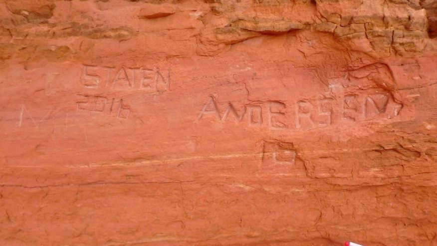 Officials at Utah's Arches National Park are investigating large graffiti deeply carved into the park's famous Frame Rock arch, Moab, Utah, April 2016 | Photo courtesy of Arches National Park, St. George News