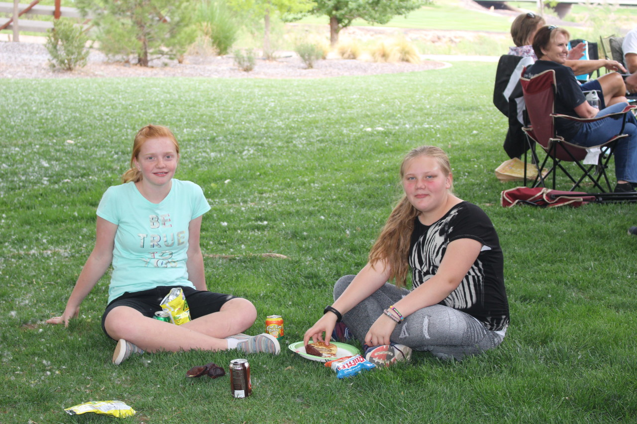 L-R: Kileigh Humphrey and Ava Geeitsen enjoying the picnic with their family, Vietnam Veterans of America Barbeque, St. George, Utah, Apr. 14, 2016| Photo by Cody Blowers, St. George News