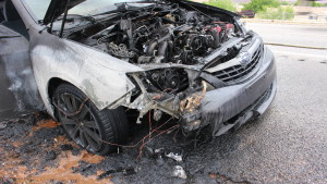 A melted engine compartment on Subaru sedan that caught fire on Interstate 15 in St. George, Utah, April 27, 2016 | Photo by Don Gilman, St. George News