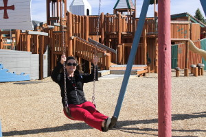 Cedar City Mayor Maile Wilson swings on the playground at Park Discovery Friday after she reopens it to the public. Cedar City, Utah, April 22, 2016 | Photo by Tracie Sullivan, St. George/Cedar City News