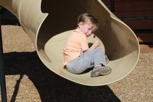 Aiden Hughes, 3, plays on the playground at Park Discovery Friday after it was officially reopened to the public. Cedar City, Utah, April 22, 2016 | Photo by Tracie Sullivan, St. George/Cedar City News