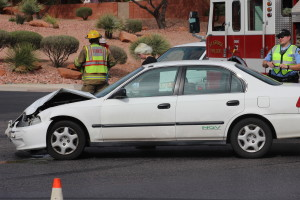 A collision between a Honda Civic and a Pontiac Firebird resulted in both vehicles being towed and a citation issued for the juvenile driver of the Pontiac in St. George, Utah, April 7, 2016 | Photo by Don Gilman, St. George News