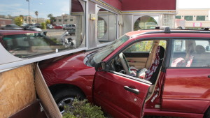 A woman lost control of her Subaru Forester and crashed into the side of Wingers Roadhouse Grill in St. George, Utah, April 21, 2016 | Photo by Don Gilman, St. George News