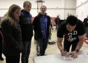 Former professional wrestler and motivational speaker Marc Mero takes time to sign autographs and shake hands with audience members after the presentation, Paiute Tribal Center, Cedar City, Utah, March 31, 2016 | Photo by Carin Miller, St. George News