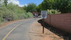 Pedestrians and a sign indicating yield guidelines for various users on the Snow Canyon Trail near Bluff Street, St. George, Utah, April 13, 2016   Photo by Tim Tabor, St. George News