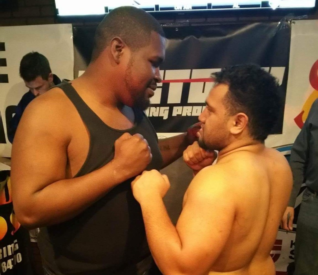 John Orr (l) and Pano Tiatia square off at the weigh-in Friday night. The two will meet in the ring Saturday night at the Dixie Center.
