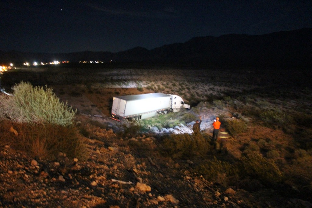 Emergency crews near semitrailer after it went off the road and landed 30-feet down an embankment on Interstate 15 northbound mile marker 5, Mohave County, Arizona, Apr. 19, 2016| Photo by Cody Blowers, St. George News