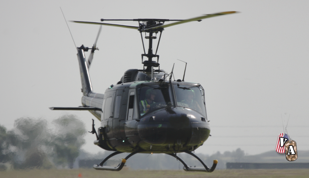 A Bell UH-1H Iroquois military helicopter - a veteran of the Vietnam War - hovers close to the ground in a thick heat haze. Green grass and trees are visible through haze generated by the weather and by the chopper's jet exhaust.   Photo by gsmudger / iStock / Getty Images Plus; St. George News