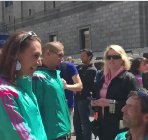 Screenshot from video. L-R Bethany Clevenger Ericksen is proposed to by Walter Brown at the site of the finish line of the Boston Marathon, Boston, Massachusetts, April 17, 2016   Image courtesy of Walter Brown