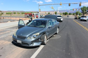 A Lexus ES350 sits at the intersection of Mall Drive and 3000 East after causing an accident Sunday morning, St. George, Utah, April 17, 2016 | Photo by Ric Wayman, St. George News