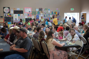 """Students, teachers and parents enjoy a soup fundraiser dinner and art night at the Circleville Community Center as part of the Piute County School District's first annual """"District Art Event."""" Circleville, Utah, April 13, 2016 
