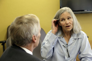Former Charles Manson follower Leslie Van Houten confers with her attorney Rich Pfeiffer during a break from her hearing before the California Board of Parole Hearings at the California Institution for Women in Chino, Calif., Thursday, April 14, 2016. The panel recommended parole for Van Houten more than four decades after she went to prison for the killings of a wealthy grocer and his wife. The decision will now undergo administrative review by the board. If upheld it goes to Gov. Jerry Brown, who has final say on whether the now-66-year-old Van Houten is released. | AP Photo/Nick Ut, St. George News