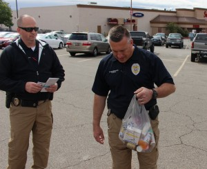 St. George Police detectives accept a bag of unused prescription drugs at the semi-annual Drug Take-Back Day, St. George, Utah, April 30, 2016 | Photo by Ric Wayman, St. George News
