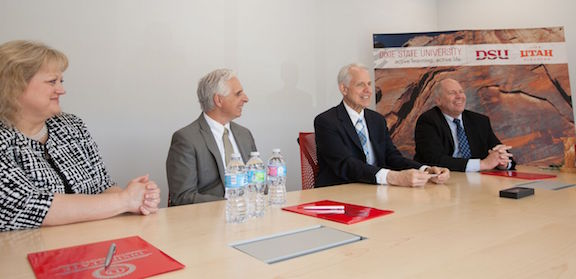 L-R: Dixie State University's Dr. Brenda Sabey and Dr. Michael Lacourse, Utah Valley University's Dr. Jeffrey Olson and Dr. Parker Fawson. The group sign memoranda to partner in a joined international student teaching experience. St. George, Utah, March 31, 2016 | Photo courtesy of Dixie State University, St. George News