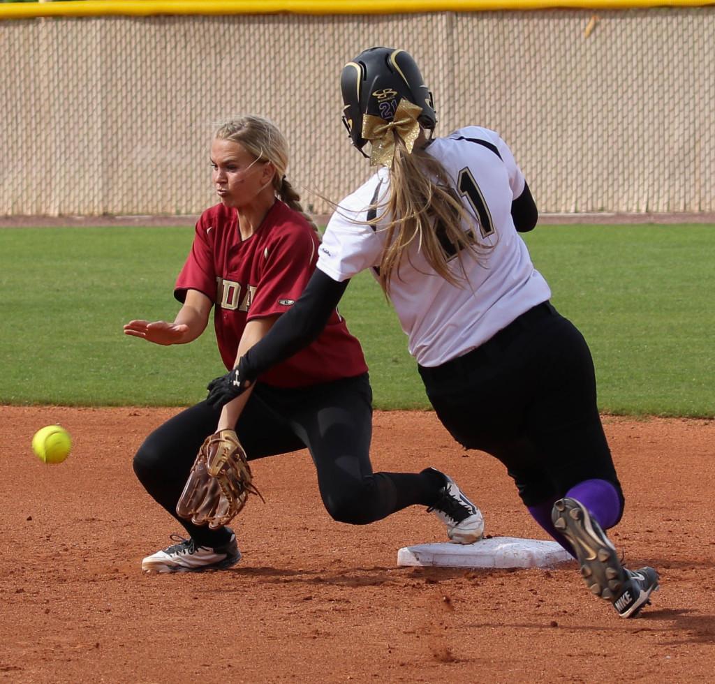 Desert Hills' Megan Wiscombe (21) and Cedar's Allie Meisner (4) Desert Hills vs. Cedar, Softball, St. George, Utah, Apr. 15, 2016, | Photo by Kevin Luthy, St. George News