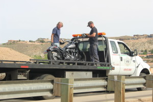 A motorcycle involved in an accident on River Road being being secured on the back of a tow truck, St. George, Utah, April 6, 2016 | Photo by Mori Kessler, St. George News