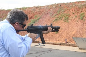 The St. George Police Department hosted the St. George City Council with a demonstration of techniques and equipment use at the police shooting and training range. During the visit, Mayor Jon Pike and Councilman Jimmie Hughes took turns shooting police firearms - all while under police supervision, of course, St. George, Utah, April 14, 2016 | Photo by Mori Kessler, St. George News