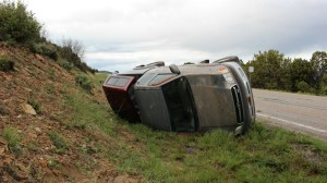 A Toyota Tundra crashed and flipped on its side on SR-18 after hydroplaning near milepost 34, Washington County, Utah, April 29, 2016 | Photo by Mori Kessler, St. George News