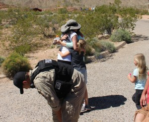 Naomi Turner is enveloped in a bear hug from her daughter, granddaughter and her other granddaughter is running toward her as well, after being missing for 16 hours on the Arizona Strip. Mohave County, Arizona, April 2, 2016   Photo by Ric Wayman, St. George News