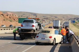 A Nissan Sentra is towed from the freeway after hitting a motorcycle rider from behind Tuesday. St. George, Utah, April 5, 2016 | Photo by Ric Wayman, St. George News