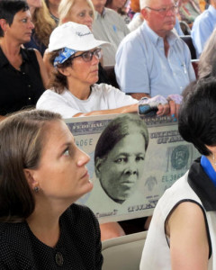 FILE - In this Associated Press file photo, a woman holds a sign supporting Harriet Tubman for the $20 bill during a town hall meeting at the Women's Rights National Historical Park in Seneca Falls, N.Y. A Treasury official said Wednesday that Secretary Jacob Lew has decided to put Harriet Tubman on the $20 bill, making her the first woman on U.S. paper currency in 100 years. Seneca Falls, New York, Aug. 31, 2015 | Photo by Carolyn Thompson, Associated Press, St. George News