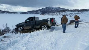 Washington County Search and Rescue volunteers pull a Florida man's truck out of the snow after the man was stranded for three days at Kolob Reservoir, Utah, March 31, 2016 | Photo courtesy Washington County, St. George News