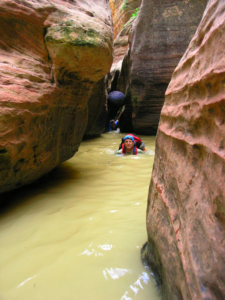 Bo Beck swimming through a chilly pool in the Subway slot canyon of Zion National Park, Utah, date not specified | Photo courtesy of Bo Beck, St. George News