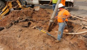City of St. George water crews work to repair a water main break on the 50 East block of 700 South that flooded a nearby townhome, St. George, Utah, May 20, 2016 | Photo by Mike Cole, St. George News