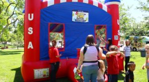 A bounce house kept children entertained during the Utah Foster Care March for Kids event in St. George, Utah, May 27, 2016 | Photo by Don Gilman, St. George News