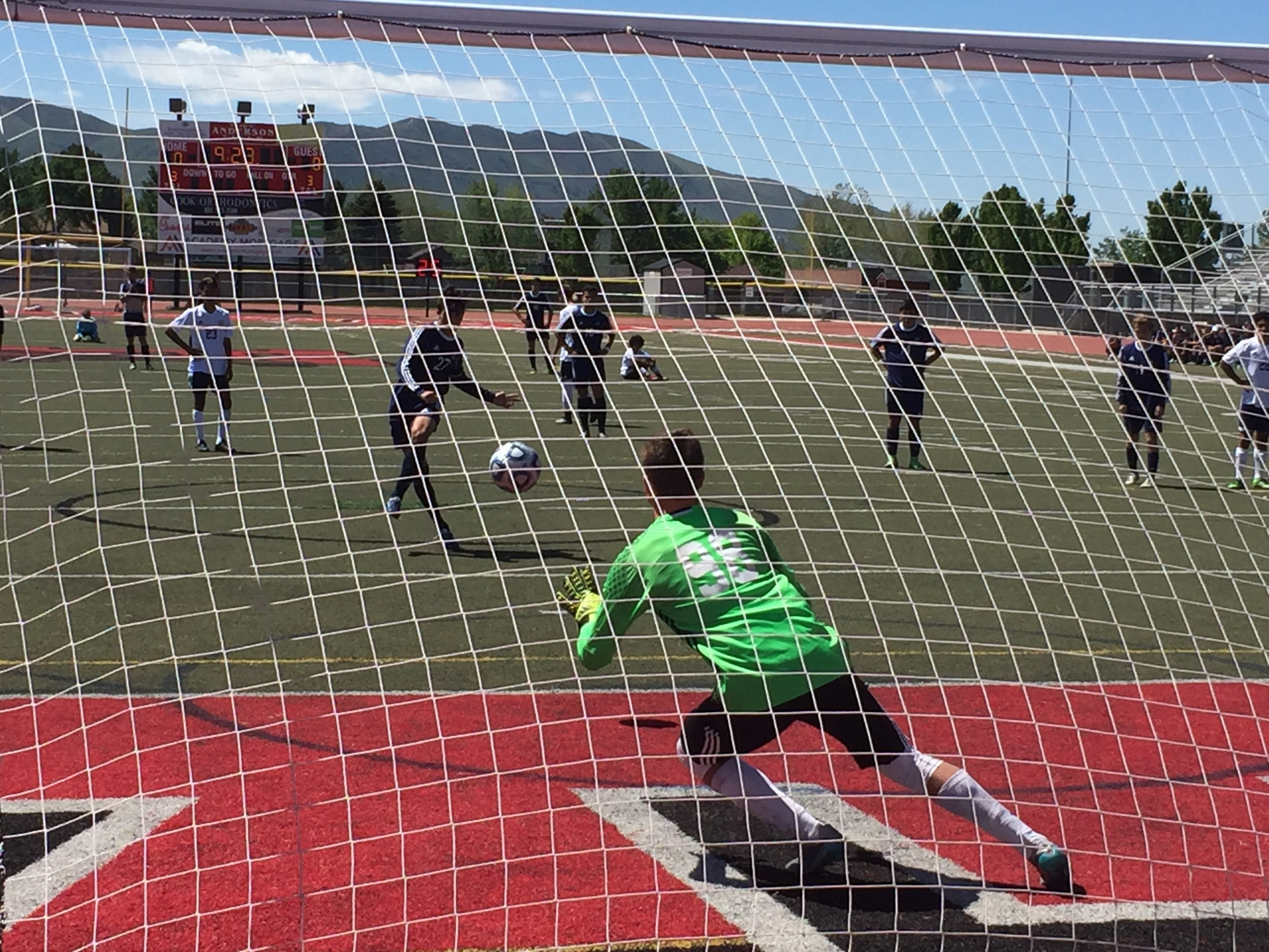 Quinn Hargis (in green) made a spectacular save on a penalty kick in the first half, Snow Canyon vs. Juan Diego, 3A state soccer championship, Sandy, Utah, May 14, 2016 | Photo by A.J. Griffin, St. George News