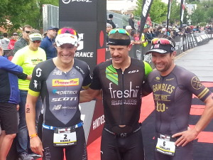 Top three pro men finishers Lionel Sanders (center), Sebastian Kienle (left) and Joe Gambles (right). Ironman 70.3 St. George North American Pro Championship. St. George, Utah, May 7, 2016 | Photo by Andy Griffin, St. George News
