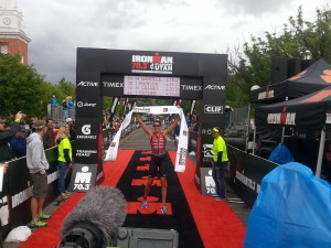 Heather Wurtele crosses the finish line in 4:16:47, first place for pro women in Ironman 70.3 St. George North American Pro Championship. St. George, Utah, May 7, 2016   Photo by Andy Griffin, St. George News