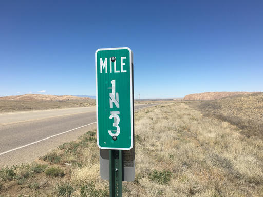 The 13 mile marker is posted off Navajo Route 36 near the San Juan Chapter, N.M., on Tuesday, May 3, 2016. An 11-year-old girl and her brother were abducted on Monday, May 2, 2016, near this mile marker off Navajo Route 36 near the San Juan Chapter, N.M., according to authorities.   Photo by Jon Austria/The Daily Times via AP; St. George News