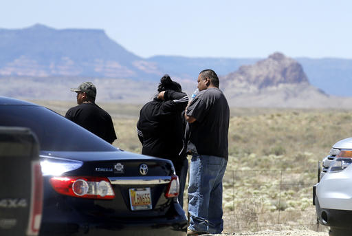 Family and friends gather along Navajo Route 13, just a few miles from where Ashlynne Mike's body was discovered, in south of Shiprock, N.M., on Tuesday, May 3, 2016. Police gleaned some information about the suspect from the younger brother of Ashlynne, whose body was found Tuesday near a distinct rock formation that the rural town of Shiprock, N.M., is named for. Authorities are poring over parts of the Navajo Nation in search of the man who snatched the children and killed Ashlynne. | Photo by Jon Austria/The Daily Times via AP; St. George News