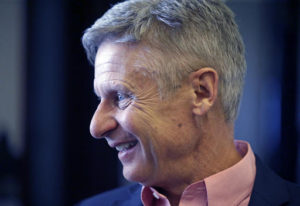 """In this May 18, 2016 file photo, Libertarian presidential candidate, former New Mexico Gov. Gary Johnson speak with legislators at the Utah State Capitol in Salt Lake City. He has virtually no money, no strategy to compete in battleground states and no plan to stop talking about his drug use. Yet with the Republican Party facing the prospect of a Donald Trump presidency, Libertarian presidential hopeful Gary Johnson could be a factor in 2016. The former two-term New Mexico governor, a Republican businessman perhaps best known for his years-long push to legalize marijuana, has a sobering message for a """"never-Trump"""" movement desperately seeking a viable alternative.