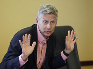 """FILE - In this May 18, 2016 file photo, Libertarian presidential candidate, former New Mexico Gov. Gary Johnson speak with legislators at the Utah State Capitol in Salt Lake City. He has virtually no money, no strategy to compete in battleground states and no plan to stop talking about his drug use. Yet with the Republican Party facing the prospect of a Donald Trump presidency, Libertarian presidential hopeful Gary Johnson could be a factor in 2016. The former two-term New Mexico governor, a Republican businessman perhaps best known for his years-long push to legalize marijuana, has a sobering message for a """"never-Trump"""" movement desperately seeking a viable alternative. 