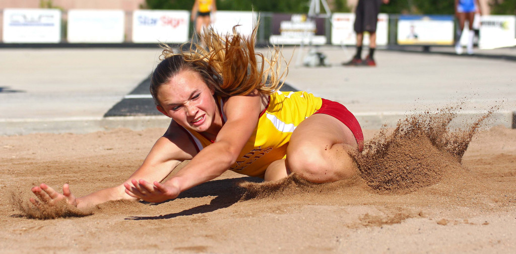 Cedar's Morgan Myers competes in the long jump, Region 9 Track and Field Championships, May 12, 2016, | Photo by Robert Hoppie, ASPpix.com, St. George News