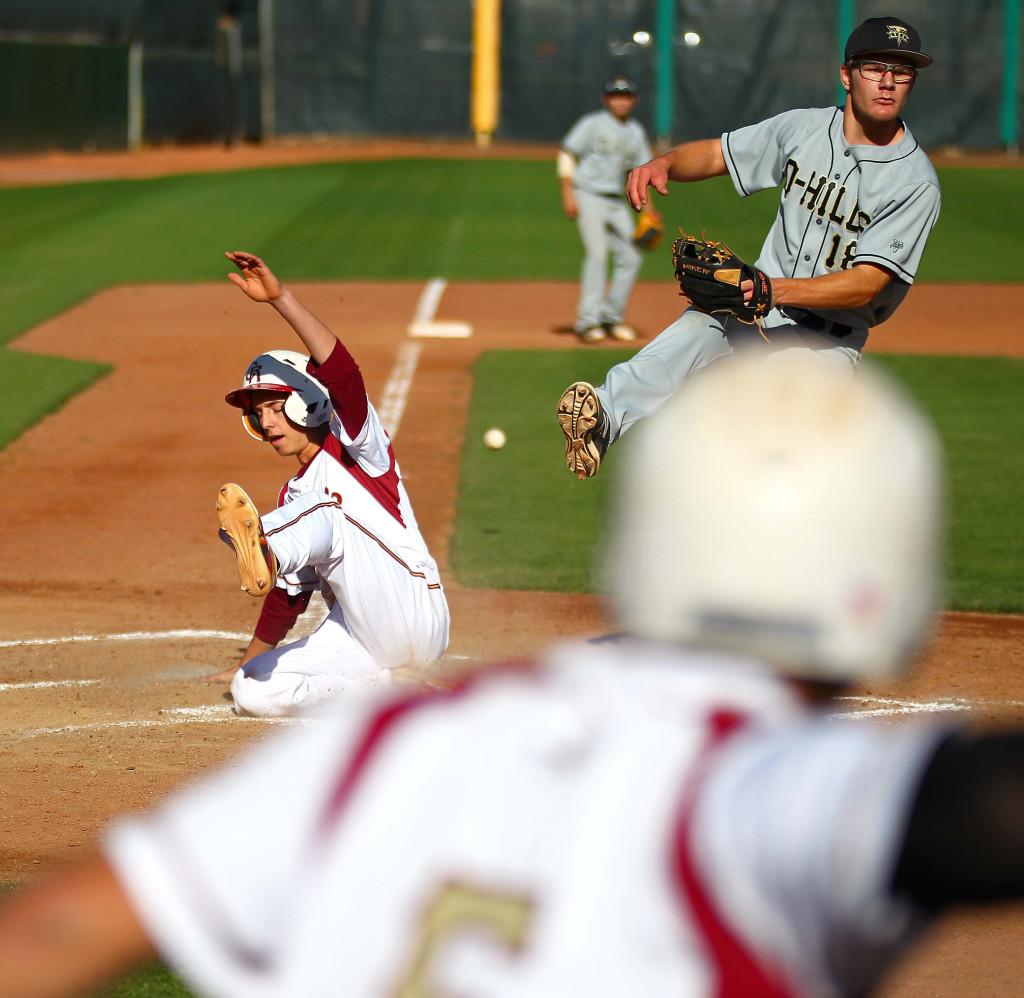 Cedar's McClain Anderson (15) scores the game winning run on a passed ball, Desert Hills vs. Cedar, Baseball, May 2, 2016, | Photo by Robert Hoppie, ASPpix.com, St. George News