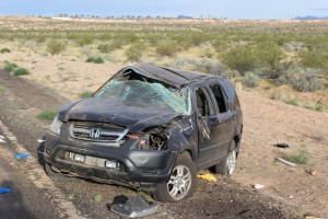 An SUV rolled early Sunday morning killing one man and injuring two children. Mohave County, Arizona, May 8, 2016 | Photo by Ric Wayman, St. George News
