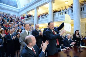 Gov. Gary Herbert displays Senate Bill 296 after signing it into state law, Salt Lake City, Utah, March 12, 2015 | Photo by Intellectual Reserve, Inc., courtesy of The Church of Jesus Christ of Latter-day Saints, St. George News