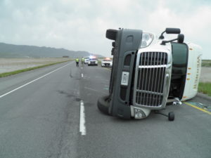 Two semis traveling eastbound on Interstate 80 near milepost 84 were both blown over by the high winds within about 5 minutes of each other, Tooele County, Utah, May 20, 2016 | Photo courtesy of Utah Highway Patrol, St. George News