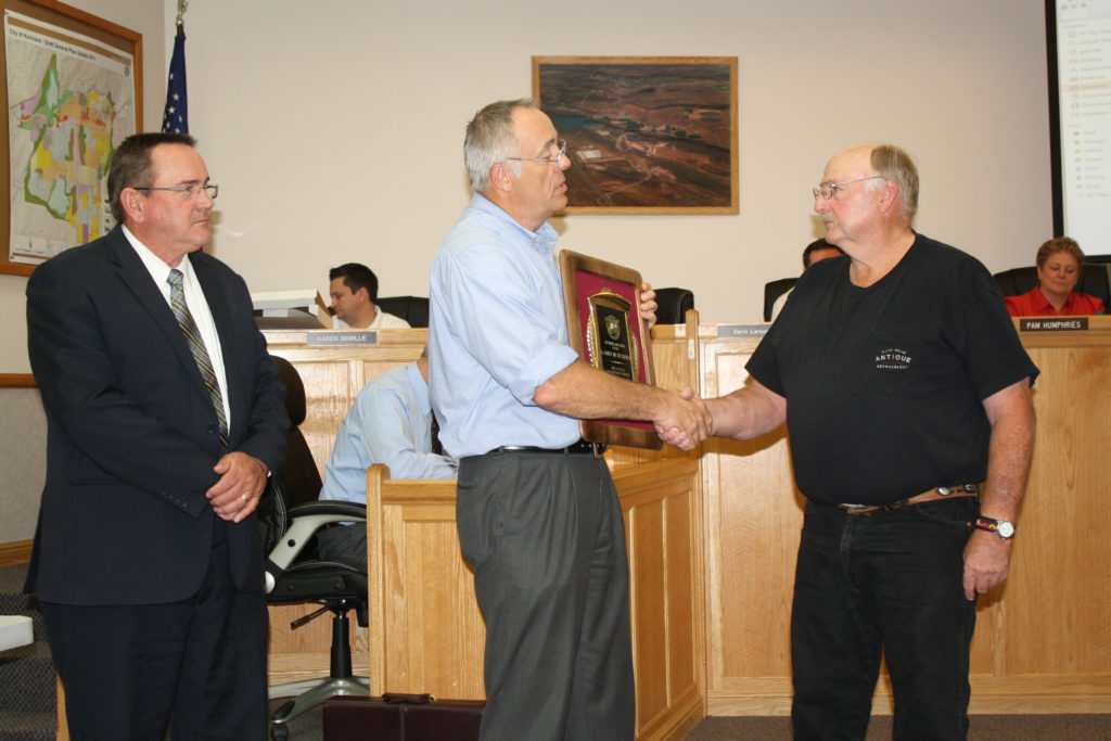L-R: City Manager Clark Fawcett and Mayor John Bramall present 30-year service award to Larry Hutchings, Hurricane, Utah, May 19, 2016 | Photo by Reuben Wadsworth, St. George News
