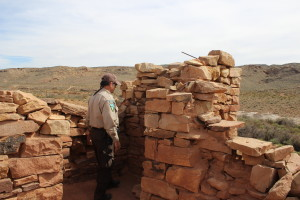 BLM Ranger Scott examines the structure of the Fort Peace ruin in Warner Valley, Utah, April 10, 2016 | Photo by Don Gilman, St. George News