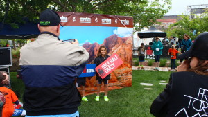 A runner gets her picture taken at the Ironman Kids Fun Run in St. George, Utah, May 6, 2016 | Photo by Don Gilman, St. George News